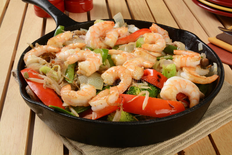 Shrimp stir fry. In a cast iron skillet royalty free stock photography