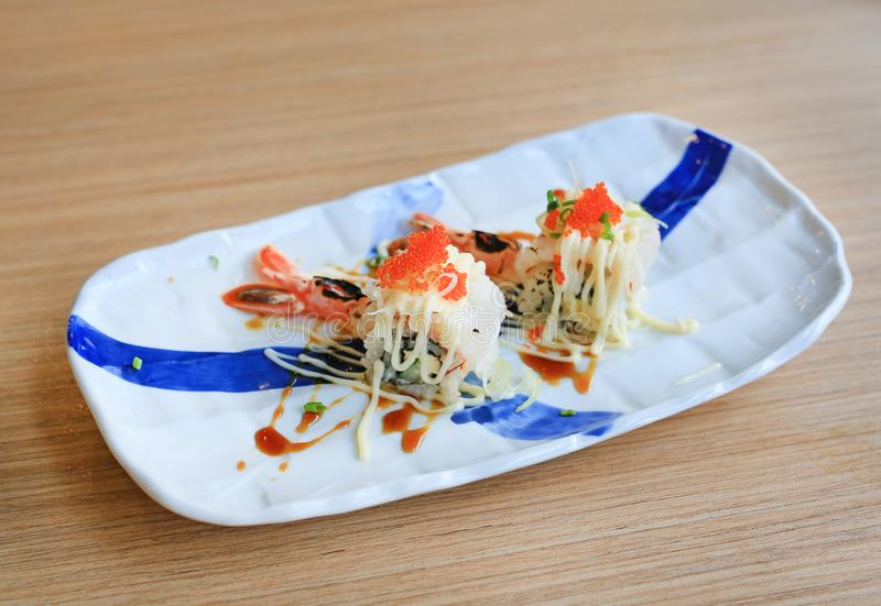 Shrimp sushi with egg in plate on wooden table. Traditional Japanese food.  stock photography