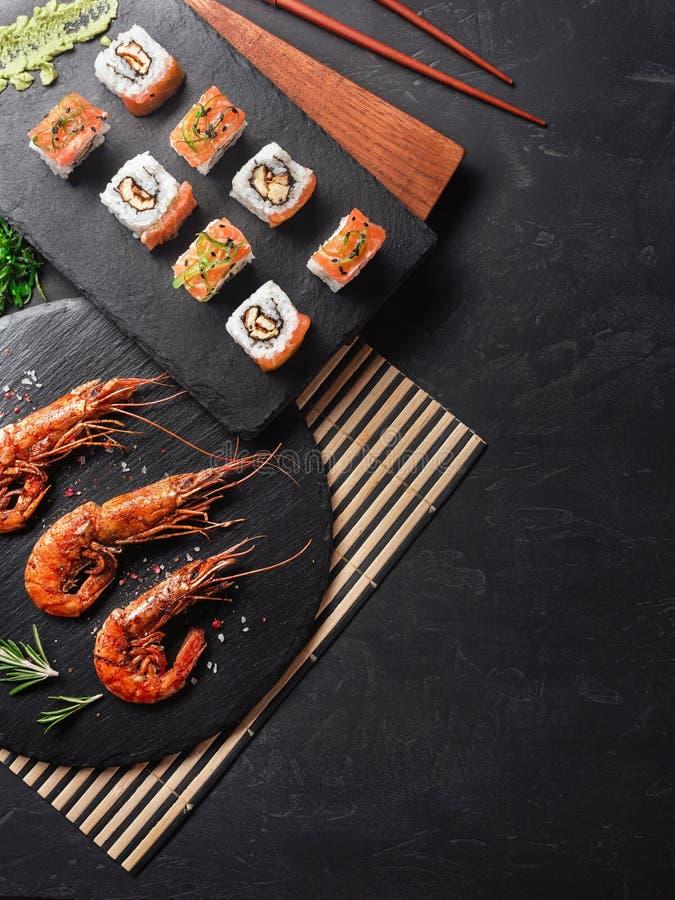Shrimp with sushi on stone table stock photos