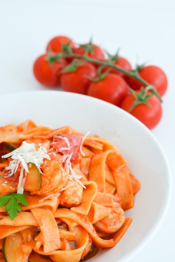 Shrimp tagliatelle with tomato sauce stock photo