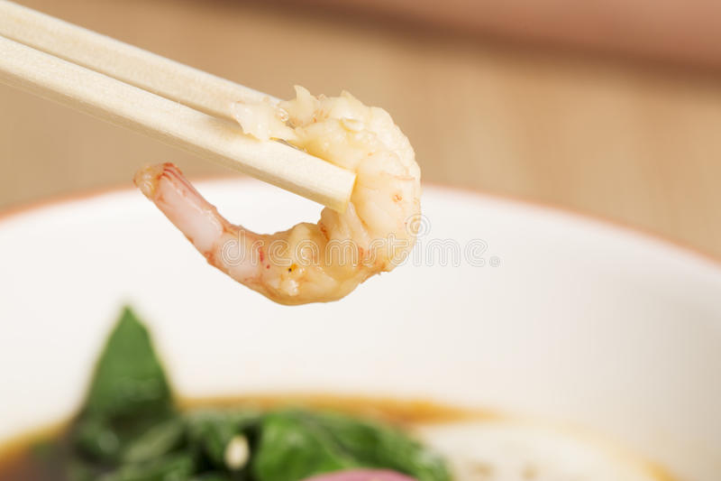 Shrimp taken from bowl of hot soup royalty free stock images