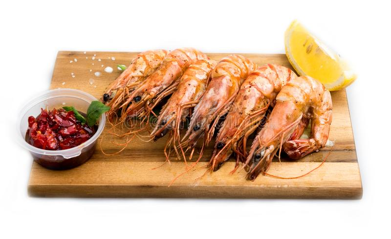 Shrimp tiger, fry in olive oil, with plenty of garlic, spices stock photos