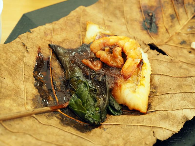 Shrimp, Vegetable and Fish meat on dry leaf royalty free stock photography