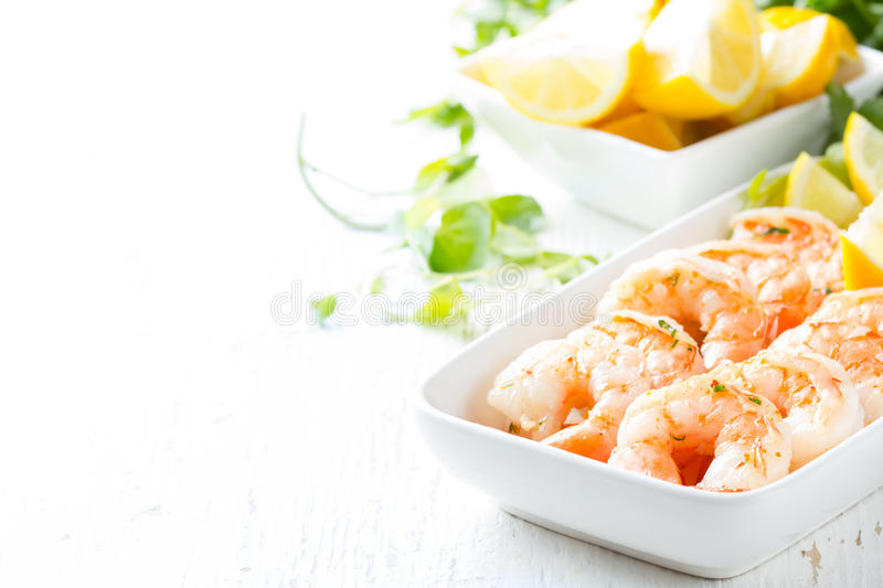 Shrimps prawns with fresh herbs and lemon stock photography