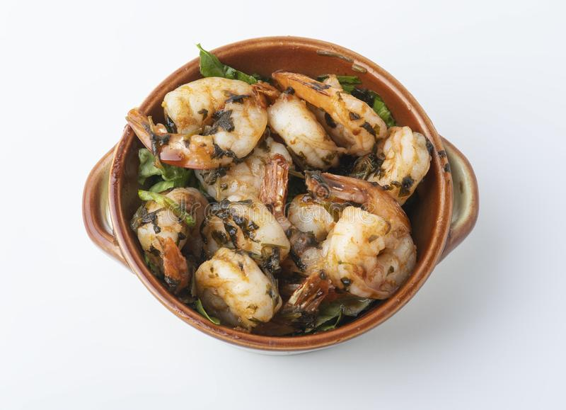 Shrimps provencal, Shrimp in Provencal in a pot  on white. Shrimps provencal, Shrimp in Provencal in a pot   on white background stock image