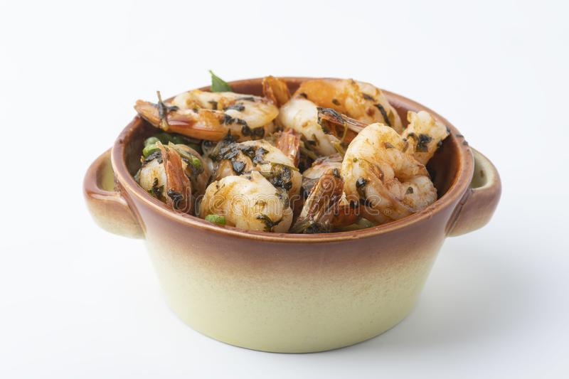 Shrimps provencal, Shrimp in Provencal in a pot  on white. Shrimps provencal, Shrimp in Provencal in a pot   on white background royalty free stock photos