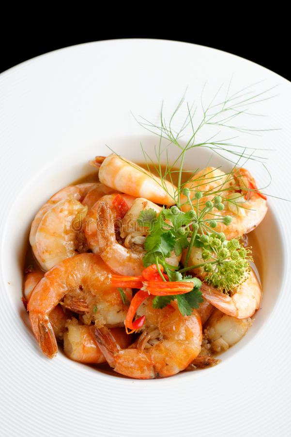 Shrimps in Singapore style royalty free stock photos