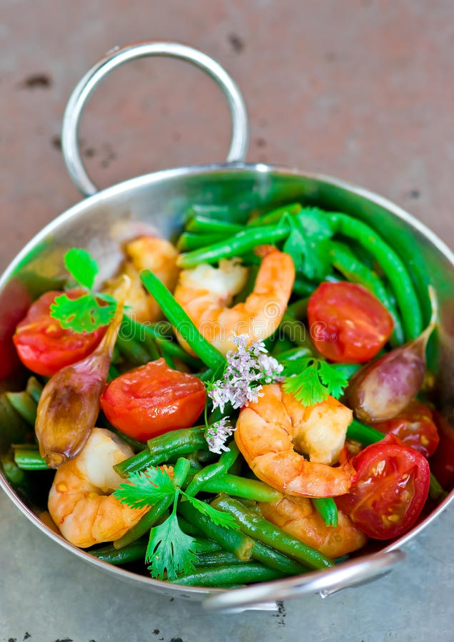 Shrimps stir fry. Srimps stir fry in to the metalic bowl royalty free stock photo