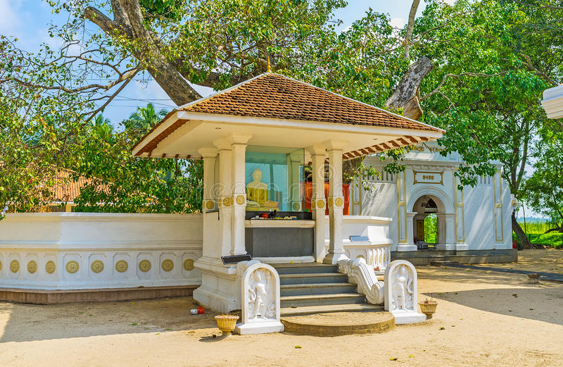 Shrine at Bo Tree. The way to the Shrine at Bo Tree of Thaniwalla Devalaya Temple decorated with Moonstone and Nagaraja guardstones fro both sides of the steps royalty free stock images