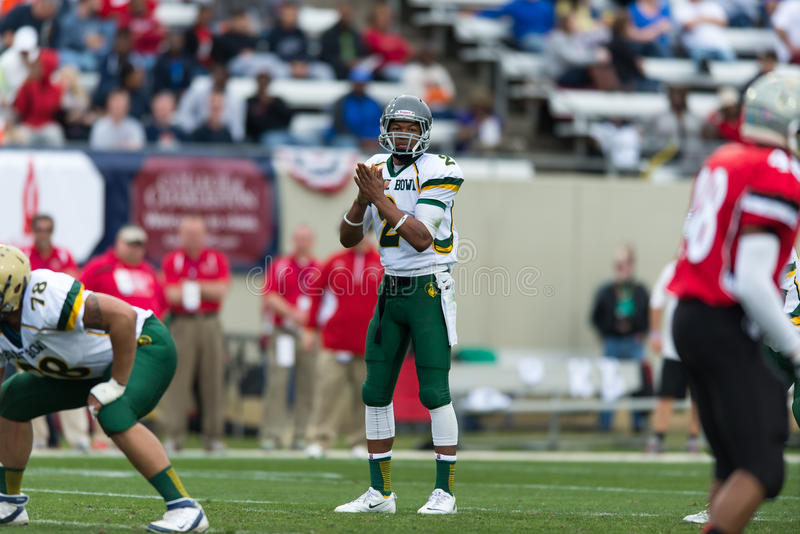 Shrine Bowl of the Carolinas. Spartanburg, SC - December 21, 2013 North Carolina QB Jalen McClendon reads the defense before the snap royalty free stock photo
