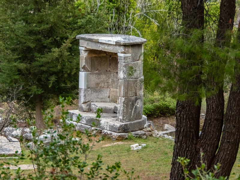 The shrine of god Dionysos at the archaeological site f Rapentosa near Athens in Greece. Monuments, travel, attraction, tourist, remains, ruins, temple stock photography