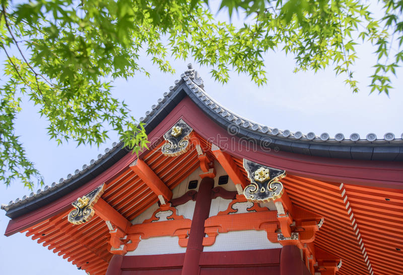 Shrine temple japan. Japan temple roof with maple leaf stock photo