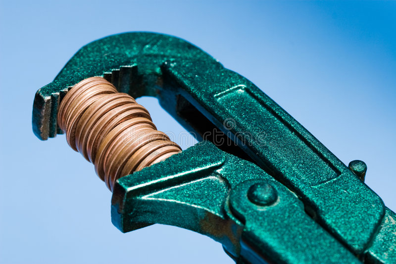 Shrink your budget. A concept image for shrinking the budget. Blue background royalty free stock image