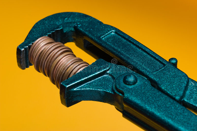 Shrink your budget. A concept image for shrinking the budget. Orange background royalty free stock photo