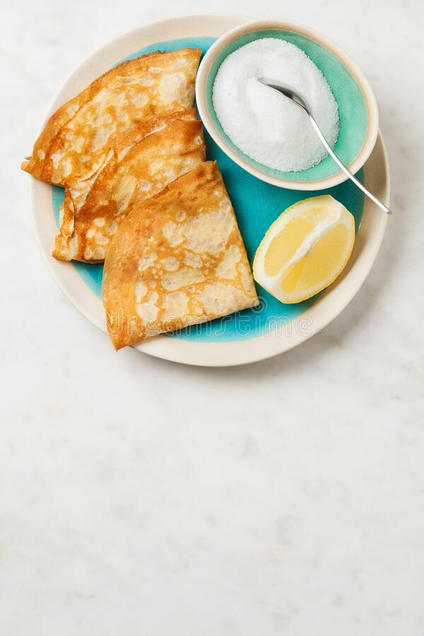 Shrove Tuesday pancakes with lemon stock photo