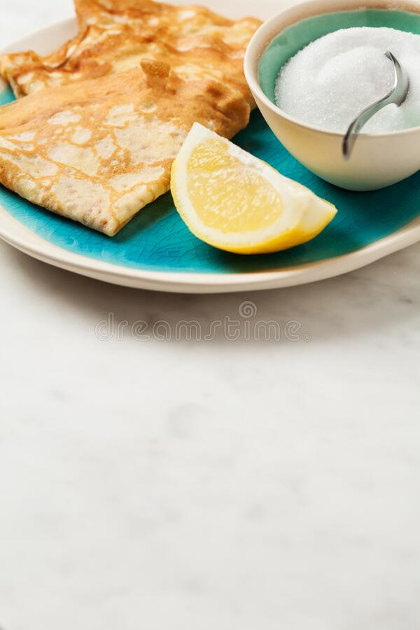 Shrove Tuesday pancakes with lemon stock images