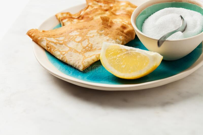Shrove Tuesday pancakes with lemon royalty free stock image