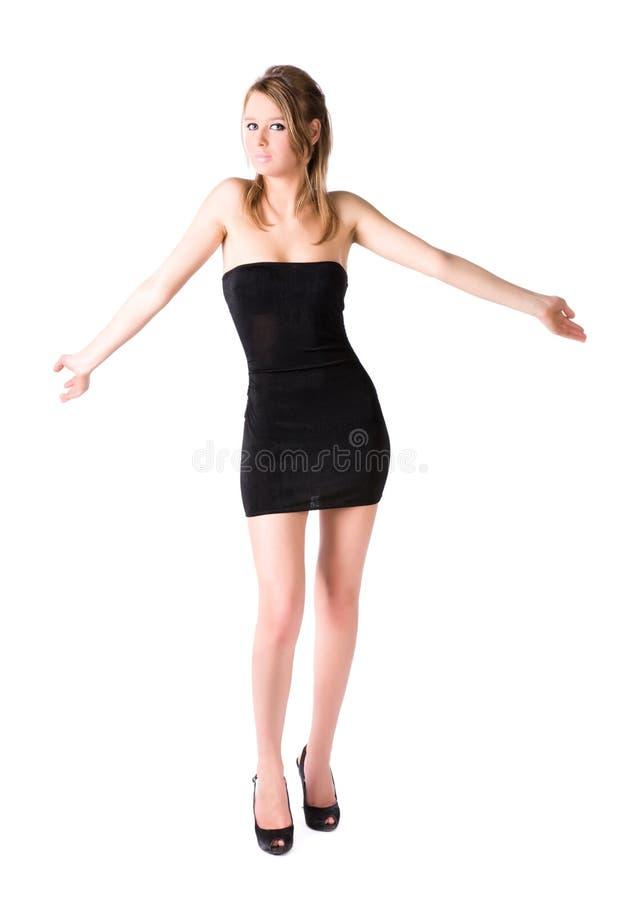 Shrug atractivo joven de la mujer sus hombros foto de archivo