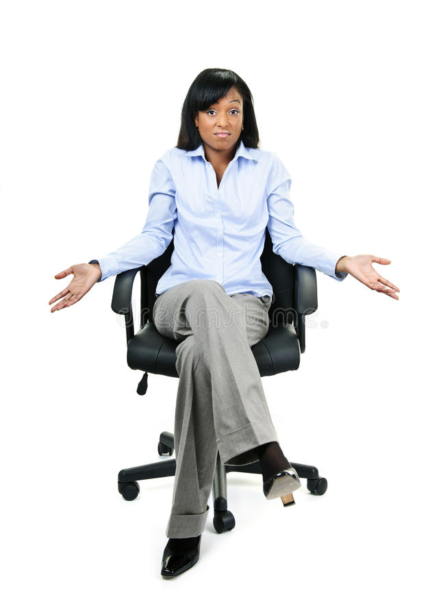 Shrugging businesswoman in office chair stock image
