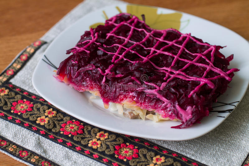 Shuba. Dressed herring (Ukrainian: Shuba) is a layered salad composed of diced salted herring covered with layers of grated boiled vegetables (potatoes, carrots royalty free stock photography