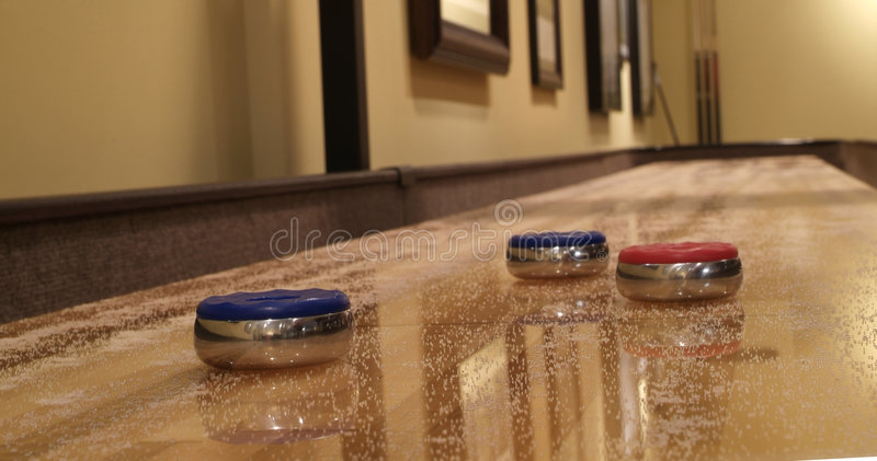 Shuffle board. Indoor Shuffleboard game with red and blue discs royalty free stock photography