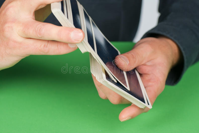 Shuffling cards stock image