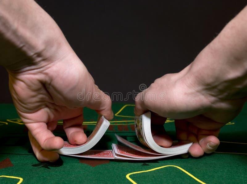 Shuffling cards royalty free stock photo