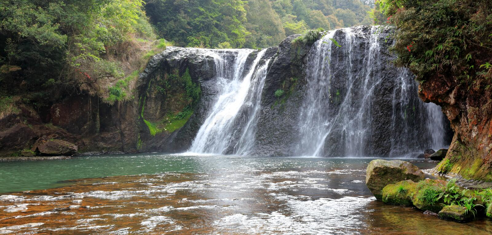 Shuhaipubu waterfall, srgb image. Shuhai waterfall in nanjing county, zhangzhou city, fujian province, china. shuhai waterfall is 45 meters wide and 21 meters