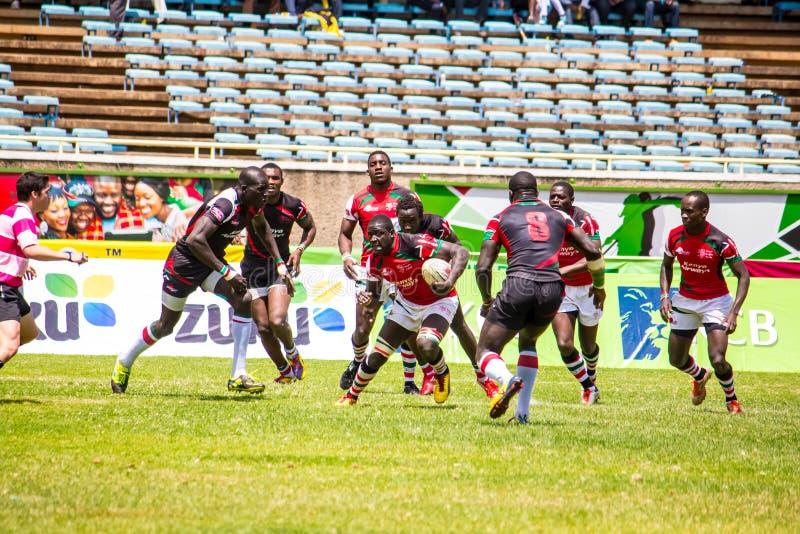 Shujaa Кении бьет Simba Saba стоковая фотография rf
