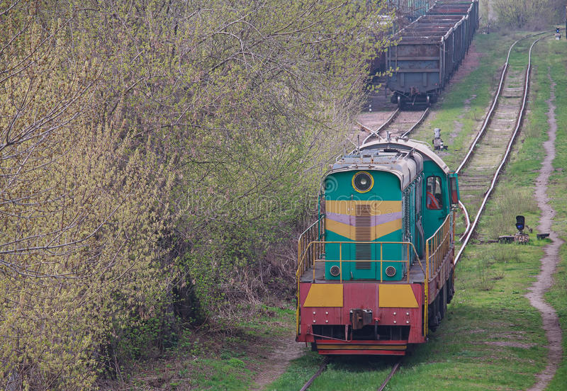 Shunting diesel locomotive standing on the siding. Transport royalty free stock photography