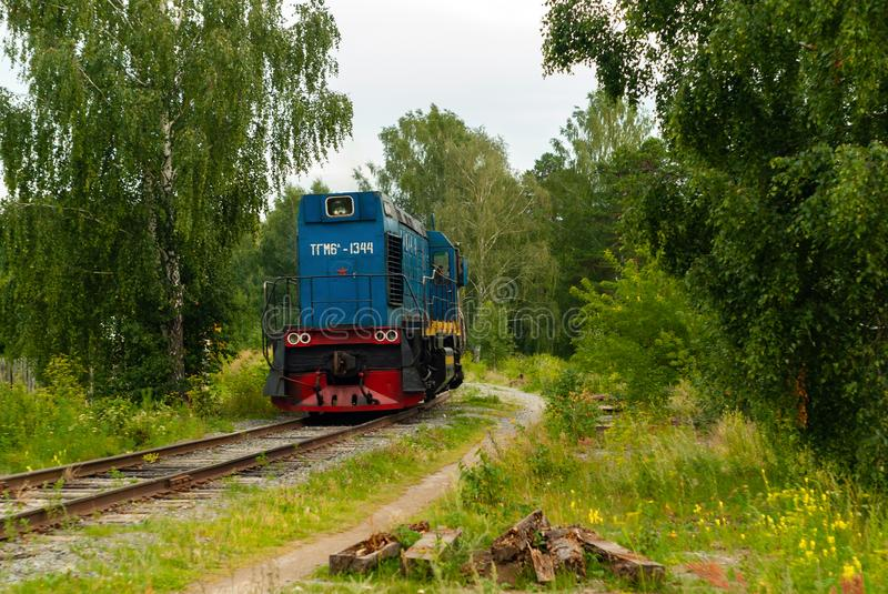 Shunting locomotive on a railway line among the forest. Yekaterinburg, Russia - July 10, 2019: shunting locomotive TGM6 on a railway line among the forest royalty free stock photo