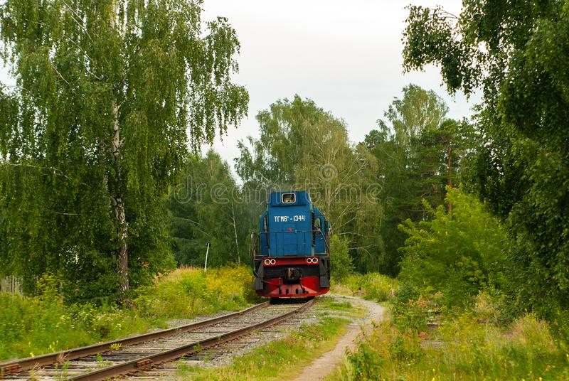 Shunting locomotive on a railway line among the forest. Yekaterinburg, Russia - July 10, 2019: shunting locomotive TGM6 on a railway line among the forest royalty free stock photos
