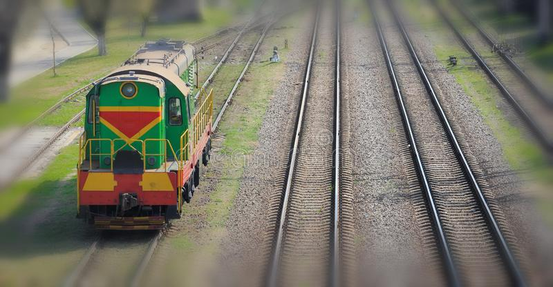 Shunting locomotive on railway station Sorting. Descent of dissolution and formation of freight trains royalty free stock images
