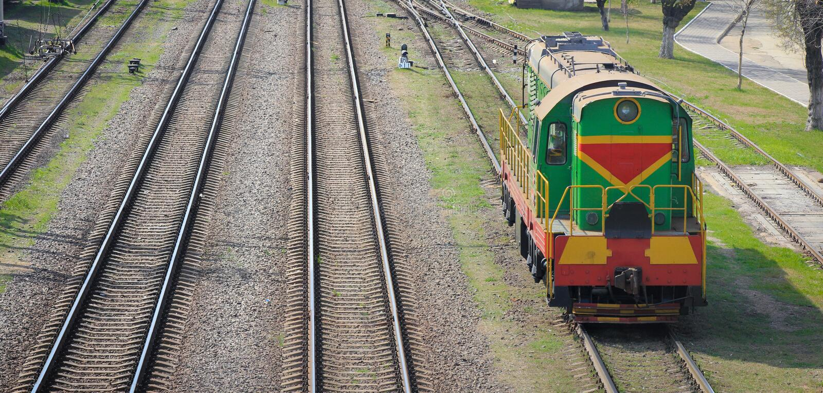 Shunting locomotive on railway station Sorting. Descent of dissolution and formation of freight trains stock image