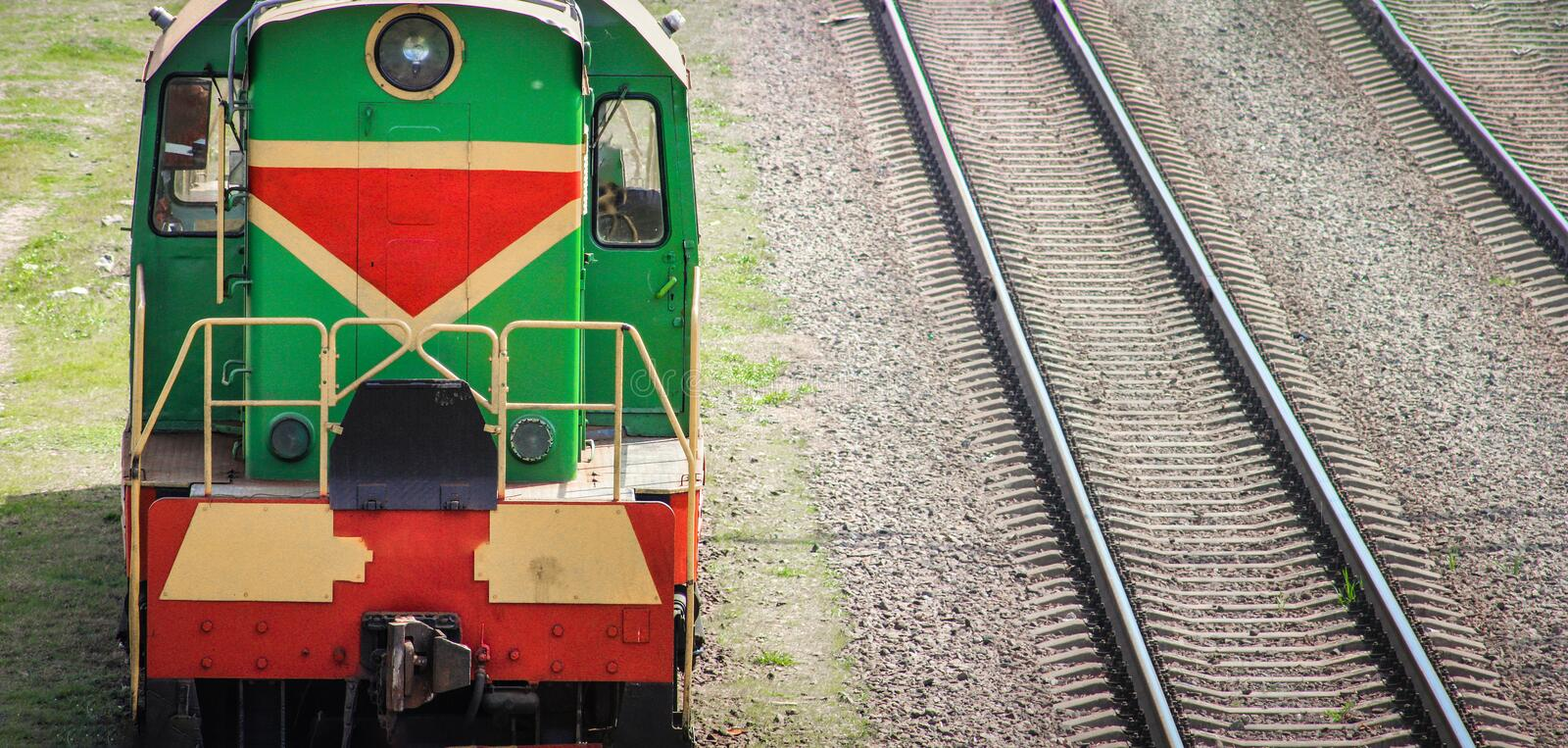 Shunting locomotive on railway station Sorting. Descent of dissolution and formation of freight trains royalty free stock image