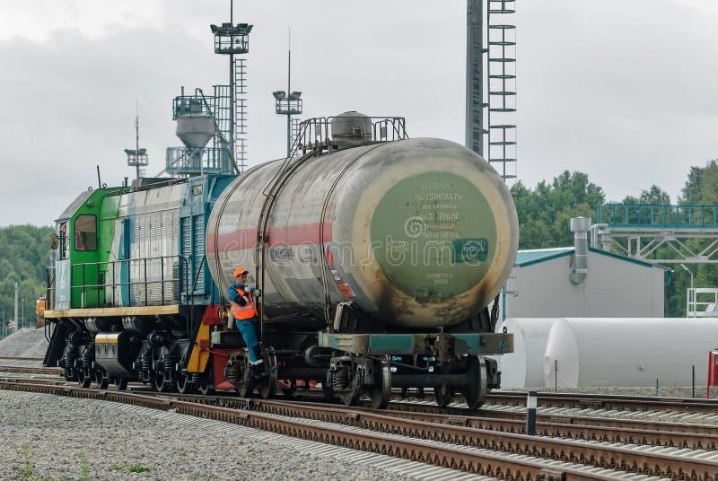 Shunting locomotive transports tank on other way. Tobolsk, Russia - July 15. 2016: Sibur company. Denisovka railway station. Shunting locomotive transports the royalty free stock photos