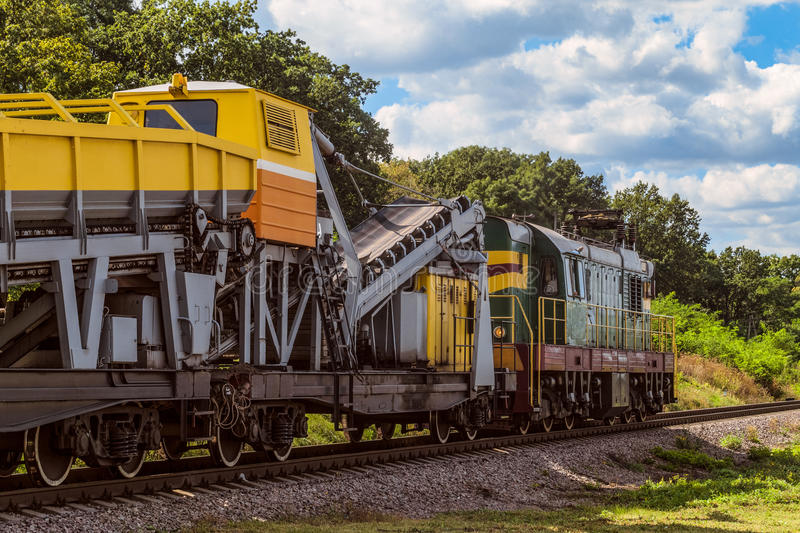 Shunting locomotive with a wagon for construction and repair of railway tracks. Diesel shunting locomotive with a wagon for construction and repair of railway stock photo