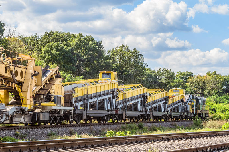 Shunting locomotive with wagons equipped with complexes for the construction and repair of railway tracks. Diesel shunting locomotive with wagons equipped with stock image
