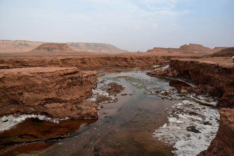 Shur River in Lut desert of Iran. Shur River or literally Salt River is the only permanent river that runs deep in the Iranian desert. The river is constantly stock photos