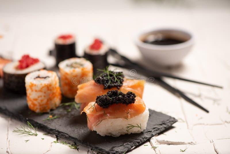 Shushi and black caviar. Close up stock photos