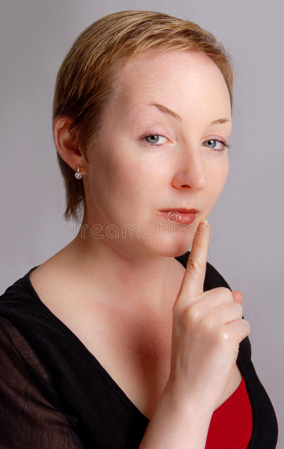Shut up. Woman warning to shut up with a serous expression royalty free stock images