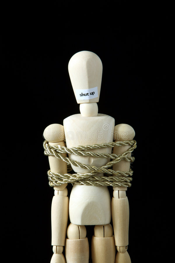 Shut up. Bind a wooden model with rope stock image