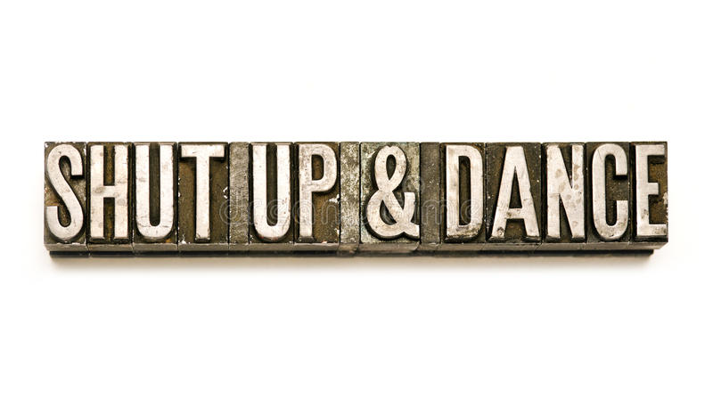 Shut Up & Dance. The phrase `Shut Up & Dance` in letterpress type. Cross processed, narrow focus royalty free stock images