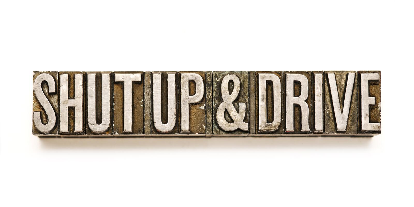 Shut Up & Drive. The phrase `Shut Up & Drive` in letterpress type. Cross processed, narrow focus royalty free stock photography