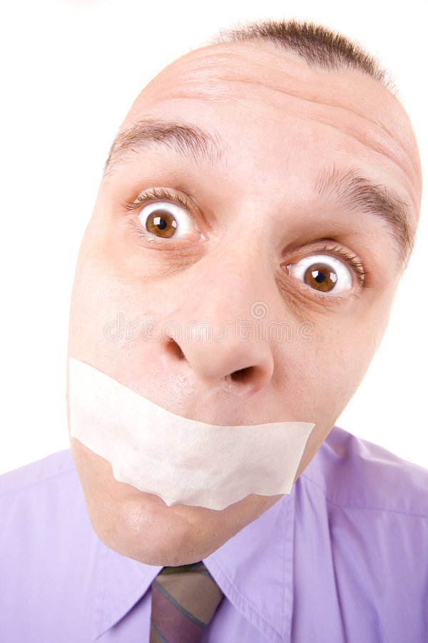 Shut up and go to work!. Confused businessman with taped mouth isolated on white stock photography