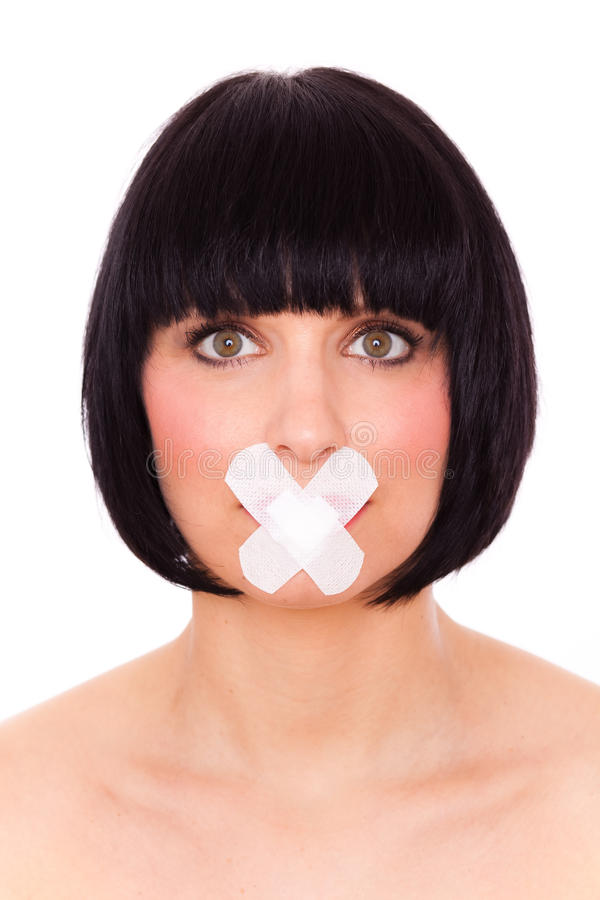 Shut up mouth. Speechless female with plaster on mouth advised to be silent royalty free stock photos