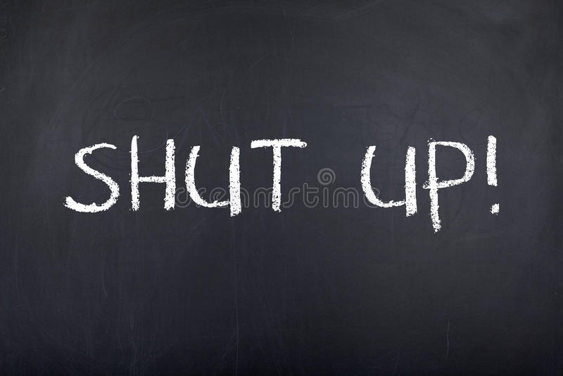 Shut Up Note. Shut up message on blackboard stock photography