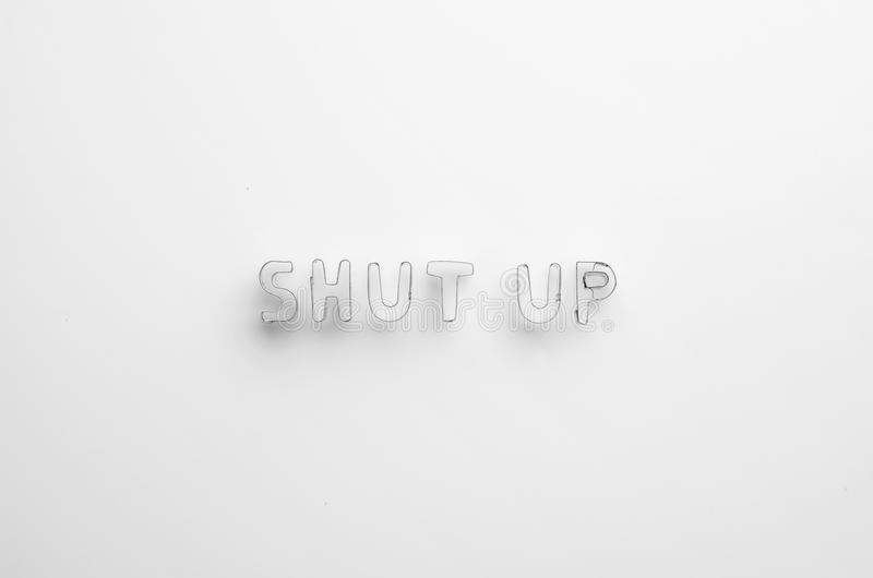 Shut up word. Over white background, top view stock photo