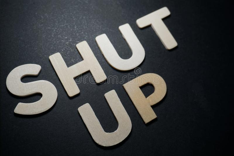 Shut up. Words in white letters on black background design pedryj creative message text illustration royalty free stock images