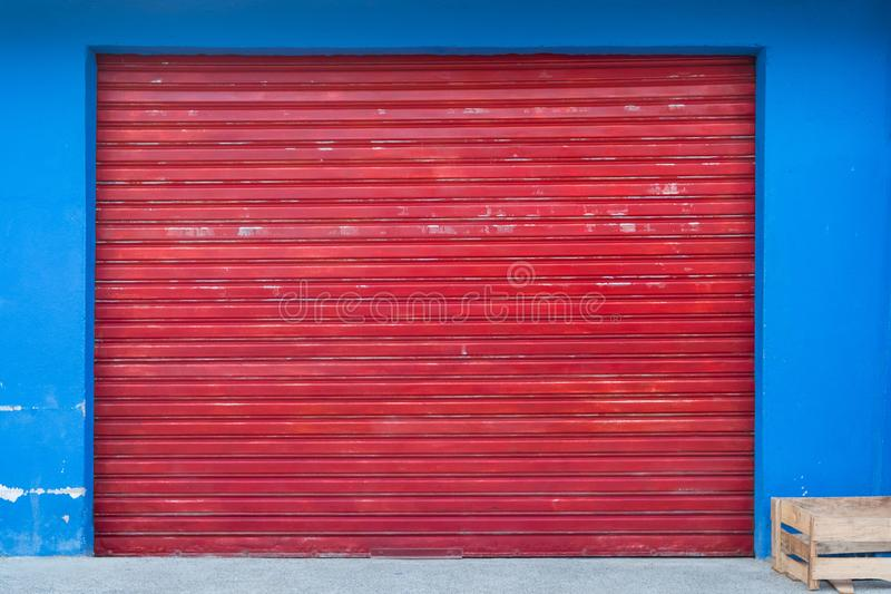 Shutter background - shop exterior with closed red shutter stock images